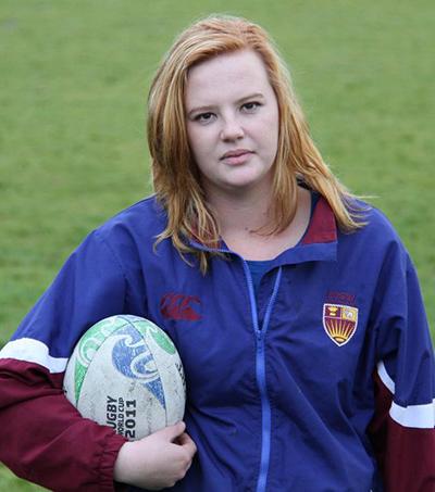 Teenage Girl Tackling Men's Club Rugby