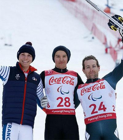 Paralympic Skier Adam Hall Earns Triple Honour