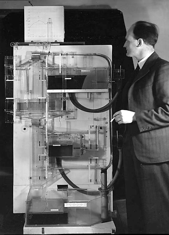 """A.W.H """"Bill"""" Phillips demonstrating his Monetary National Income Analogue Computer"""
