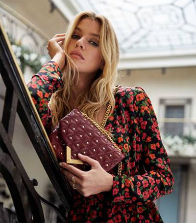 Model Stella Maxwell Designs Bag for The Kooples
